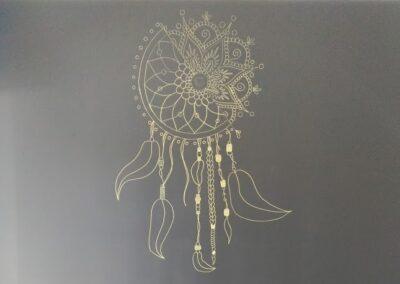 Attrape rêve doré pour une décoration murale en fresque